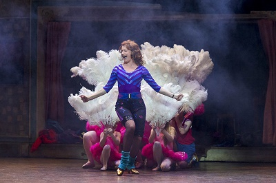 Photo by Alastair Muir: Annette McLaughlin as Mrs Wilkinson with the Ballet Girls